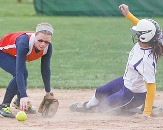 Champion's Sierra Blackson (1) slides safely into second base after Niles McKinley's Brooke Lawson (9)