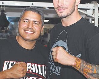 Youngstown's Kelly Pavlik, right, poses with trainer Robert Garcia at Thursday's media day in San Antonio. Pavlik will fight Aaron Jaco in a 10-round super middleweight bout on Saturday.