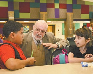 Dr. Robert Walls, principal of Campbell Elementary School, chats with Hector Lopez, 9, and Faith Fetty, 10, at the end of a recent school day. Walls is a finalist for the 2012 Ohio Association of Elementary School Administrators Distinguished Principal Award.