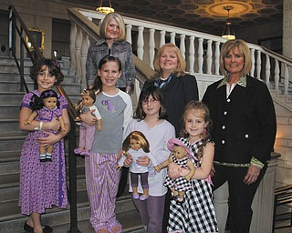 Four of the young girls who will participate as models in the American Girl Doll Fashion Show presented by Kids' Crew of Akron Children's Hospital Mahoning Valley on April 28 and 29 at Stambaugh Auditorium are, left to right, Andrea Dull, 8, of Hubbard, Olivia Cmil, 8, of Boardman, Zoe Simon, 9, of Poland and Paige Fluent, 5, of Poland. Behind them are, from left to right, Gayle Kelly, chairman of Kids' Crew, JoAnn Stock of Akron Children's Hospital and Betty Cmil of Kids' Crew.