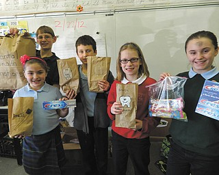 Students at Holy Family School in Poland display some of the dental supplies they donated to the Rescue Mission on Ash Wednesday. Toothbrushes, toothpaste, dental floss and many other supplies were sent. From left to right are Audrey Kali, grade three; Mario Abbattista, grade eight; Stephen Babik, grade five; Maren Abbattista, grade four; and Katherine Kali, grade five.
