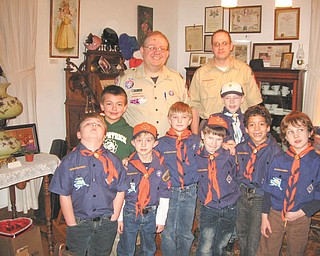 Cub Scouts from Dens 3 and 7 of Hubbard Pack 100 and their Scout leaders, Andy Yoder and Chuck James, above, and many of the  parents toured the Hubbard Historical Society's McBride House on a recent Wednesday night. Group tours can be arranged from times outside the regularly scheduled open house, which is from 2 to 5 p.m. the second Sunday of each month. There is no charge, but donations are accepted. Call Cecilia Cooper at 330-534-4247 to arrange a tour.