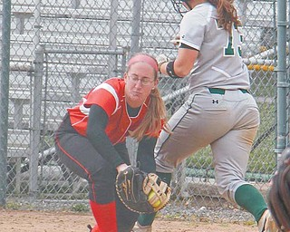 Youngstown State's Courtney Ewing (8) catches the ball to force Cleveland State baserunner Salena Kauffman (73) out at first base during the top of the sixth inning at Sunday's softball game at McCune Park in Canfield. The Penguins won 7-1 to complete a weekend series sweep of the Vikings.