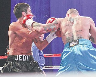 """Youngstown's Kelly """"The Ghost"""" Pavlik lands a left hook on the jaw of Aaron """"Jedi"""" Jaco in the second round of their super middleweight bout Saturday at the Alamodome in San Antonio, Texas. The shot knocked Jaco to the canvas and earned Pavlik a win by TKO."""