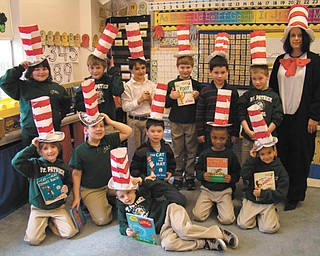 At St. Patrick School in Hubbard, Mrs. Mellony Leonard's second-grade class celebrated Dr. Seuss's 108th birthday with a day of activities that tied into their lessons. The class was read a story and discussed the various rhymes in it and how some made sense and some were fun nonsense words. The class made their own hats to help celebrate the day. In the afternoon the class watched a Dr. Seuss movie and had popcorn and other snacks. The class comprises, in front, Sam Wirtz; middle row, from left to right, Jayden Johnston, Nate Wirtz, Bobby Lucarell, Matt Jacobs and Vincent LeBron, In the back are Isabella Canzonetta, Tristan Beil, Vincent DePizzo, Ian Smith, Danny Lucarell, Aidan Ealy and Mrs. Leonard.