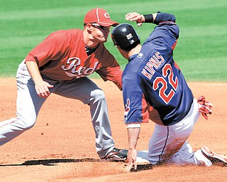 Cincinnati Reds shortstop Zack Cozart tags out Cleveland Indians' Jason Kipnis (22) on an attempted steal of second in the first inning of Monday's spring training game in Goodyear, Ariz. Kipnis is one of the Indians' young players being counted on 2012.