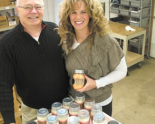 """Becki Olejnik and her father, Richard Conti, are part owners of Sydney Candle Co. in Cortland. Initially, Olejnik and her family made candles in a basement """"with goggles and a Bunson burner."""" Conti was retired and would do the testing and formulating of the wax."""