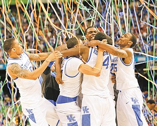 Kentucky players celebrate following their 67-59 victory over Kansas for the NCAA basketball championship at the Superdome in New Orleans. Anthoyn Davis, who finished with six points, 16 rebounds, five assists, six blocked shots and three steals in the championship game, was named the tournament's Most Outstanding Player.