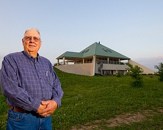 Lewayne Peterson stands in front of the pyramid home he built in Justin, Texas near Fort Worth with wealth he gained from gas drilling on his land.
