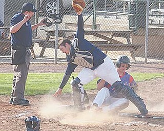 Parker Clegg slides home to score for Western Reserve as Lowellville's Nick Micco loses the ball.