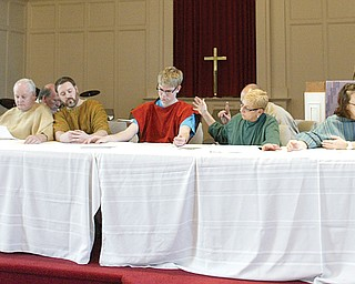 """Members of Central Christian Church in Warren practice being """"frozen"""" in place to echo the Leonardo da Vinci painting of the Last Supper. Eleven of the 12 apostles participated in a recent rehearsal for the """"Living Last Supper,"""" which the church will present at 7 tonight for its observance of Maundy Thursday."""