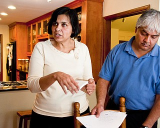 Ranjana Bhandari, left, and Kaushik De have lived off Division Street in Arlington, Texas, for 19 years. It was a nice place, they said. Now they fear for their family's health because of the numerous gas wells.