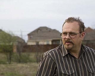 Gary Hogan stands in his Fort Worth neighborhood where fracking was introduced with no warning — just clanking steel and screeching brakes on the property behind his home. Work continued that first day until 3 a.m. Hogan and his councilman vowed it would not happen again to others, and the nation's first city ordinance on fracking were born. The Fort Worth laws have been a template for other cities.