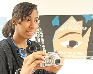 Youngstown Early College student Torri Session shoots video for the school's online yearbook during an open house Thursday at the school. The open house was part of YEC's National Early College High Schools Week observance.