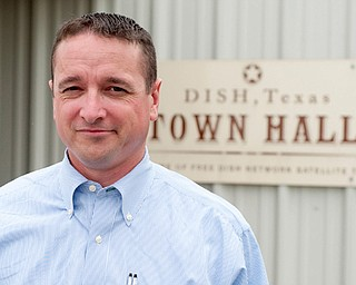 Calvin Tillman, former mayor of Dish, Texas, who stands in front of the town hall.