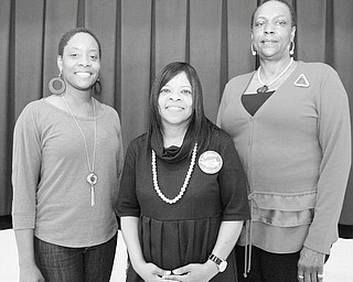 Photo by Jessica M. Kanalas | The Vindicator: Delta Sigma Theta Sorority alumnae are getting ready to step out in the name of health. Their third annual adults-only health fair is being planned for May 5 at Williamson Elementary School in Youngstown. Committee members include event chairwoman Marcia Haire-Ellis, at right, and Chantelle Hallman, left. Williamson School Principal Wanda Clark is in the center.