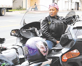 """Sondra """"Honey"""" Jones of Youngstown sits on her motorcycle at Jokers Wrath on Market Street in Youngstown, waiting for the rest of the """"Dangerous Curvez"""" motorcycle club. The group participated Sunday in a motorcycle run to raise money for Trayvon Martin's family."""