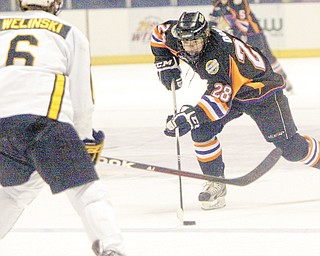Phantoms forward Alexander Dahl shoots past Green Bay's Andrew Welinski during a recent game at the Covelli Centre.