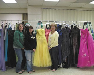 Boardman Evangel Baptist Church, 5248 Southern Blvd., Boardman, will host its first prom dress giveaway from noon to 4 p.m. Saturday. Organizers have collected more than 100 dresses, and there also will be shoes and jewelry. They are pleased to be able to offer participants an opportunity to enjoy prom without the costs associated with it. Displaying some of the dresses are, from left, Lisa Rohrman, Angela Ford and Lynda Hawkins. High school girls are encouraged to come early to try on their favorite gently worn dresses.