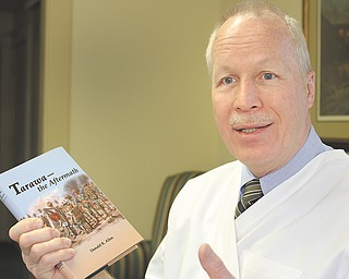 """Donald K. Allen is a Boardman veterinarian, but he's also the author of """"Tarawa: the Aftermath"""" and is among many local authors whose work has been highlighted by groups at the public library. He recently spoke at the Austintown library."""
