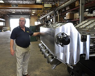 David Capps, operations manager at FTS, stands in front of a pump manufactured by the Fort Worth based company.