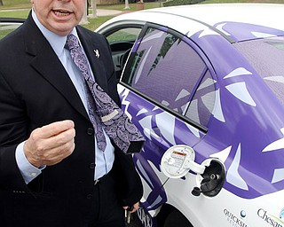 Ken Morgan, director of the Energy Institute at TCU, shows off his natural gas-powered Honda Civic as he explains the benefits.