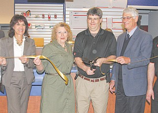 From left, Liberty Township Administrator Pat Ungaro, Trustee Jodi Stoyak, U.S. Postal Service Retail Specialist Fran Dalpiaz, Giant Eagle Vice President of Operations Bob Graff , Trustee Chairman Stan Nudell and Store Director Jeff Saluga stand before the Giant Eagle post office during a Tuesday ribbon-cutting ceremony. It is the first post office in Liberty in five years.
