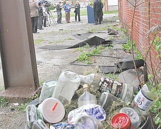 Beverage bottles fill a garbage can outside a condemned former bakery on Youngstown's South Side as U.S. Sen. Sherrod Brown, D-Ohio, and local leaders conduct a Tuesday news conference to promote the Project Rebuild Act now being considered by Congress. The Project Rebuild Act would replace the Neighborhood Stabilization Plan and would provide about $15 billion in assistance and grants to communities to renovate or tear down dilapidated structures.