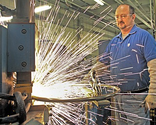 Mark Fuller, one of about 125 employees at Mahoning Valley-based Gasser Chair, welds a chair part. Gasser makes all of its furniture at its Liberty Township and Holmes County, Ohio, facilities.