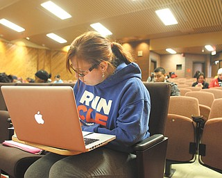 Youngstown State University student Sara Weigel of Poland takes notes during a class in a lecture hall/auditorium inside DeBartolo Hall on campus. Auditoriums inside DeBartolo, Cushwa and Ward- Beecher halls are being updated starting next month.