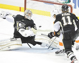 The Pittsburgh Penguins' Jordan Staal (11) watches as the Philadelphia Flyers' Jakub Voracek, back right, scores the game-winning goal past Penguins' goalie Marc-Andre Fleury (29) during the overtime period in Game 1 of the Eastern Conference quarterfi nals Wednesday at Consol Energy Center in Pittsburgh. The Flyers won 4-3 to grab a one-game lead in the series.