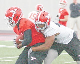 Youngstown State sophomore linebacker Teven Williams (45) tackles junior wideout Kevin Watts during Wednesday's practice at the WATTS. Williams is one of the top returnees on a young Penguin defense.
