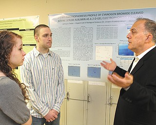 Omega Laboratories CEO John Vitullo, right, a 1975 Youngstown State University graduate, speaks with YSU students Danielle Fontaine and Joshua Pastor. Vitullo returned to campus Friday to speak to the biology department about drugs in the United States. Omega, of Mogadore, Ohio, is an organization that creates drug-testing products.