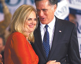 Republican presidential candidate Mitt Romney and his wife, Ann, hug during a victory rally in Schaumburg, Ill.