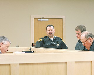 Judge Joseph M. Houser, left, presides over the opening session of the new Boardman Court, 8110 Market St., on Thursday afternoon. Appearing before him on operating a vehicle while intoxicated and drug possession charges is Matthew Tomko, 22, of Canfield. Tomko's lawyer, far right, is Stephen Garea.