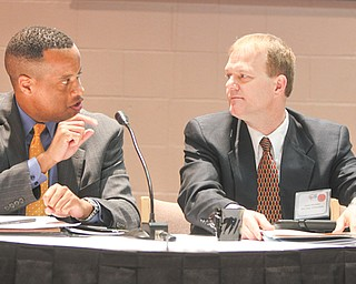 Jay Williams, left, former Youngstown mayor and current executive director of the U.S. Office of Recovery for Auto Communities and Workers, makes a point at Thursday's manufacturing summit in Youngstown. Jim Herrholtz, assistant superintendent for the division of learning for the Ohio Department of Education, listens.