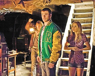 """Fran Kranz, left, Chris Hemsworth and Anna Hutchison star in """"The Cabin in the Woods."""""""