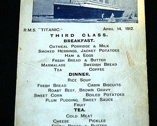 An original Titanic third class menu postcard is seen at the Larz Anderson Auto Museum in Brookline, Mass., Sunday, May 1, 2005.  Detailing the meals available on April 14, 1912 is seen on one side of the card. The item will be auctioned off with other rare Titanic relics at the Museum. (AP Photo/Chitose Suzuki)