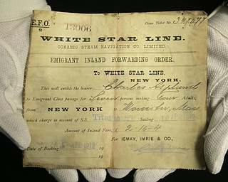 A unique emigrant inland forwarding order to the White Star office in New York, is seen at Henry Aldridge and Son auctioneers in Devizes, Wiltshire, England Thursday, April 3, 2008. The order, expected to fetch 20,000-30,000 pounds, US$ 39,000-59,000, euro25,000-38,000 was recovered from the body of Carl Asplund who drowned on the Titanic and is part of the Lillian Asplund collection of Titanic related items which go on auction on April 19.  Asplund was 5 in April 1912, when the Titanic hit an iceberg and sank on its maiden voyage from England to New York. Her father and three siblings were among 1,500 people who died. (AP Photo/Kirsty Wigglesworth)