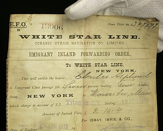 A unique emigrant inland forwarding order to the White Star office in New York, is seen at Henry Aldridge and Son auctioneers in Devizes, Wiltshire, England Thursday, April 3, 2008. The order, expected to fetch 20,000-30,000 pounds, US$ 39,000-59,000, euro25,000-38,000, was recovered from the body of Carl Asplund who drowned on the Titanic and is part of the Lillian Asplund collection of Titanic related items which go on auction on April 19.  Asplund was 5 in April 1912, when the Titanic hit an iceberg and sank on its maiden voyage from England to New York. Her father and three siblings were among 1,500 people who died. (AP Photo/Kirsty Wigglesworth)