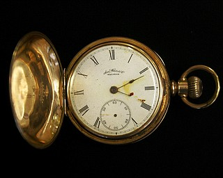 A gold plated Waltham American pocket watch, the property of Carl Asplund, is seen at Henry Aldridge and Son auctioneers  in Devizes, Wiltshire, England Thursday, April 3, 2008. The watch, expected to reach 15,000- 20,000 pounds, euro19, 000-25,000, US$30,000- 39,000 was recovered from the body of Carl Asplund who drowned on the Titanic and is part of the Lillian Asplund collection, the last American survivor of the disaster, which go on auction on April 19. Asplund was 5 in April 1912, when the Titanic hit an iceberg and sank on its maiden voyage from England to New York. Her father and three siblings were among 1,500 people who died. (AP Photo/Kirsty Wigglesworth)
