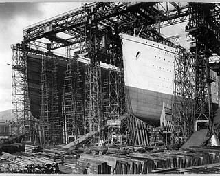 This undated image obtained from the Library of Congress shows views of the Olympic, right, and the Titanic in shipyard construction scaffolding in Belfast, Northern Ireland. The tragic sinking of the Titanic nearly a century ago can be blamed on low grade rivets that the ship's builders used on some parts of the ill-fated liner, two experts on metals conclude in a new book. (AP Photo/Library of Congress)