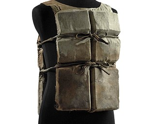 This photo provided by Christie's auction house shows a life preserver from the ill-fated R.M.S. Titanic found during the initial search for survivors and owned by the same family for 90 years.  Going on the auction block in June, it is the first Titanic life jacket to be offered at auction in the United States, and is one of about six believed to have survived to this day, Christie's said Thursday, May 29, 2008. (AP Photo/Christie's Images, Ltd.)