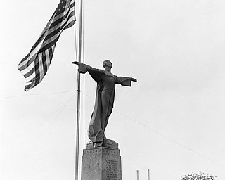 """A memorial to the men who perished in the Titanic disaster of 1912 was unveiled in Washington, D.C., on May 26, 1931, near the Licoln Memorial. The memorial is dedicated to the """"men who gave their lives that woman and children might be saved"""". President Hoover was among the many distingueshed guests. (AP Photo)"""