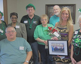 Approximately 100 seniors gathered at the Austintown Senior Center on March 15 to celebrate St. Patrick's Day with a potluck dinner. During the event, members honored Austintown Trustee Lisa Oles, second from right, for her support and volunteer hours at the center. Members of the center's Advisory Council, from left, are Carol Ricker, chairwoman; Ron Borngesser; Ann Clark; Bill Bilicki; Betty Panno; Jim Henshaw, center director; and, far right, Gloria Habib.