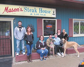 """Mason's Steak House, 38135 Salem-Unity Road, Washingtonville, will host a Build-a-Burger for Rescue fundraiser from 3 to 8 p.m. Tuesday. """"You've Been Taxed, Now Relax"""" is the theme for the event, where supporters and volunteers from the Humane Society of Columbiana County will serve meals and carryouts. A portion of the proceeds and tips will benefit the agency. There will be a basket auction, prize wheel and giveaways. Patrons are asked to take paper towels, laundry detergent, trash bags, clay kitty litter, bleach and other shelter items to exchange for raffle tickets. Preparing for the fundraiser are, from left, HSCC volunteers Jesse Dobson, Nikole Davis and Katie Erwin; steakhouse owners and their pets Chris Mason with Clea and Mary Ann Mason with Chevas; and steakhouse employees Taylor Toothman and Kayla Smith. For information call 330-332-2600."""
