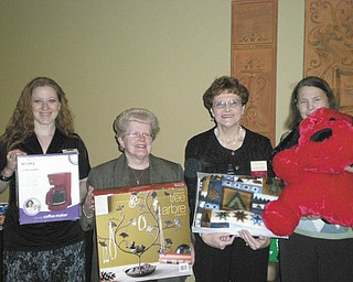 Members of the Mill Creek Chapter of American Business Women's Association will have their annual basket auction April 22 at the Ursuline Center, 4280 Shields Road, Canfield. The doors will open at 12:30 p.m., and the drawing will begin at 3. There will be door prizes for $150, $100 and $50. Shown, from left, holding some of the basket items are chapter members Mandy Codespote, Judy Codespote, Jackie Fischio and Joyce Billock. The cost of admission is $5, which includes 25 chances on raffle items, door prizes and refreshments. Proceeds will benefit the chapter's education fund.