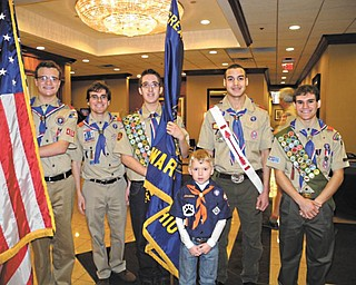 More than 170 people recently attended the seventh annual Celebration of Scouting fundraiser breakfast at the Holiday Inn in Boardman. So far, this year's event has raised $24,243. As they prepare for the opening ceremony, the color guard pauses for a moment. From left are Eagle Scouts Joe Belgrade, Vincent Calautti, Marcus Masello, Mark Verostko and Anthony Calautti. Cub Scout Stephen Yerian is in front. Absent from the picture are Eagle Scout William Wainio and Cub Scout J.P. Yerian. The Whispering Pines District of the Greater Western Reserve Boy Scout Council serves families in Mahoning County and Hubbard, with 1215 youths involved in 42 units supported by 536 adult volunteers.