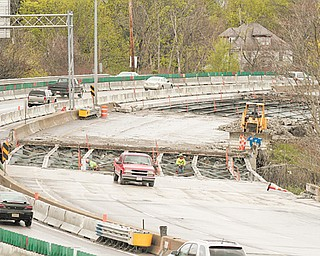 Construction crews pull off old bridge decks to build new ones along Interstate 680 northbound between South Avenue and Market Street. Two projects on the interstate cost about $19 million. The entire seven-bridge project on I-680 is projected to be completed in July 2013.