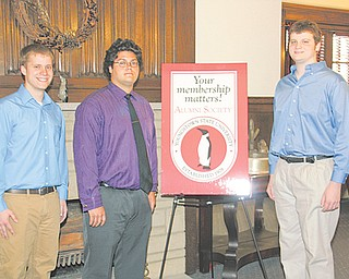 From left, Joseph Cochran of Pulaski, Pa., Michael Giambattista of Canfield and Taylor Brandt of Leavittsburg are honored as Alumni Legacy scholarship recipients at the YSU Alumni House on Sunday.
